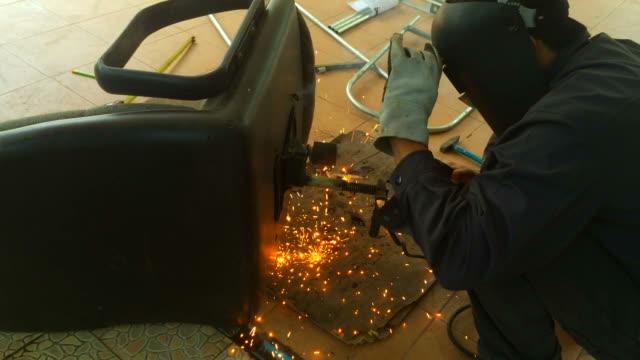 Welder welding office chair.Repair and build concept video