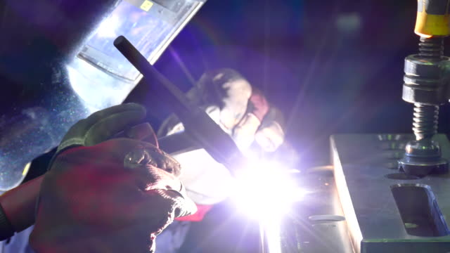 Welder Welds in a Metal Industry video