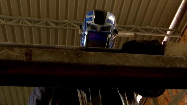 Welder worker in the metal industry video