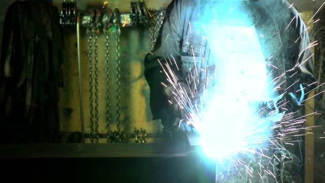 Welder working in heavy industry video
