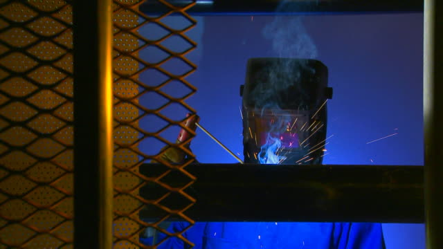 welder working on pipes video