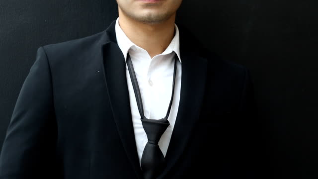 Well dressed business man adjusting his neck tie video
