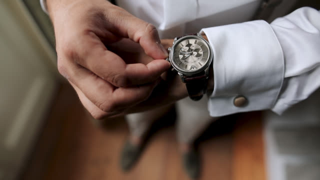 Well Dressed Man Checking Time On His Wrist Watch Well Dressed Man Checking Time On His Wrist Watch wristwatch stock videos & royalty-free footage