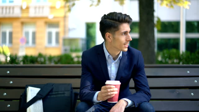 Well-dressed man having his morning coffee on the street video