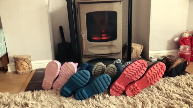 Welly boots drying by a log burner video