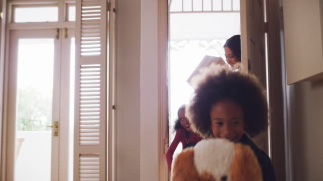 We're all excited to create special memories in this house 4k video footage of a beautiful young family carrying cardboard boxes and walking into their new home new home stock videos & royalty-free footage