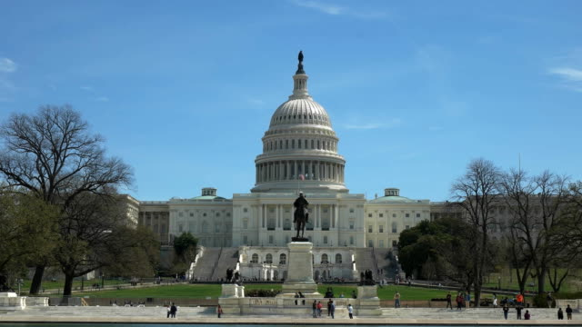 west side of the capitol building on a sunny spring morning in washington - capitello video stock e b–roll