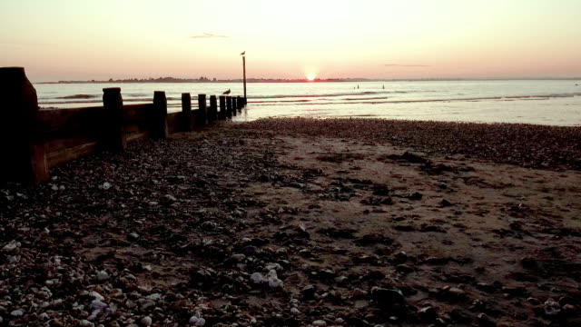 west wittering beach at sunset - west sussex - united kingdom - sussex occidentale video stock e b–roll