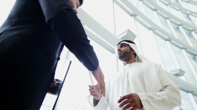 western arab international businessmen meeting with wireless tablet - arab стоковые видео и кадры b-roll