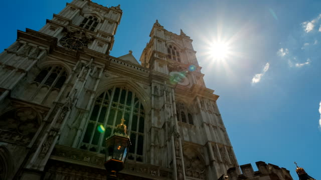 Westminster Abbey, London, England, UK Ultra wide-angle contre-jour shot of the famous Westminster Abbey, stage of royal weddings and coronations in London, England, UK royalty stock videos & royalty-free footage
