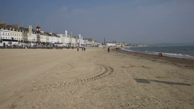Weymouth beach and seafront Dorset UK popular tourist resort video