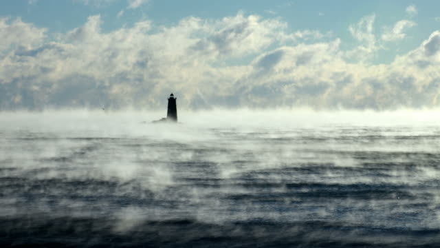 Whaleback Light In Arctic Sea Smoke Frigid arctic sea smoke at Whaleback Lighthouse at the mouth of the Piscataqua River between New Castle, New Hampshire and Kittery, Maine. condensation stock videos & royalty-free footage