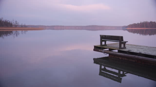 Wharf and bench at dark and moody Baltic Sea
