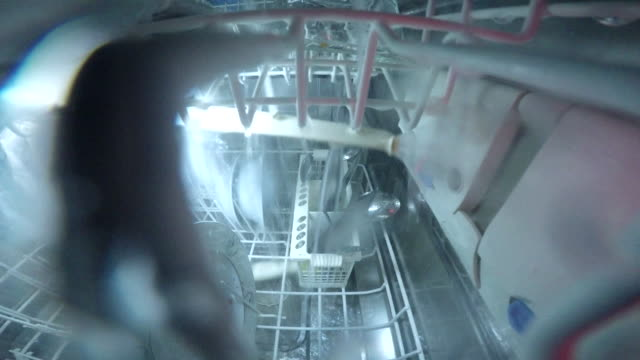 what happening inside the dishwasher PART 04/10  - what happening inside the dishwasher - dishwater on duty dishwasher stock videos & royalty-free footage