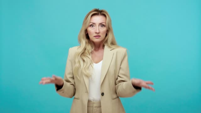 what? serious strict middle aged woman in business suit shocked and irritated with news, dissatisfied with badly completed task, frustration - communication problems stock videos & royalty-free footage