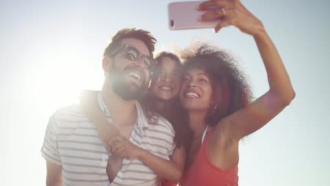 What special memories these will be 4k video footage of a happy family taking selfies at the beach family stock videos & royalty-free footage