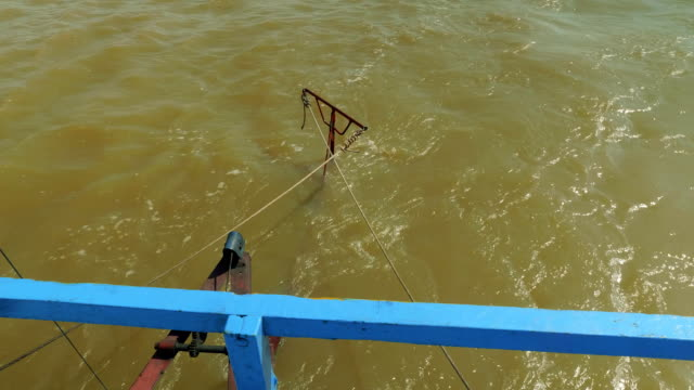 Wheel control of boat in Cambodia on lake Tonle Sap video