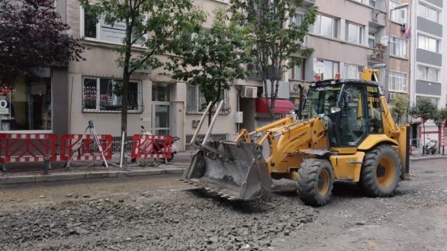 Wheel loader digging street asphalt road Wheel loader digging street asphalt road construction equipment stock videos & royalty-free footage