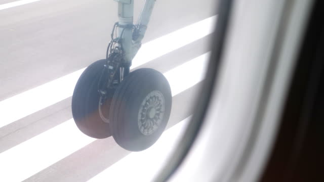 Wheel of an airplane taking off in 4k slow motion
