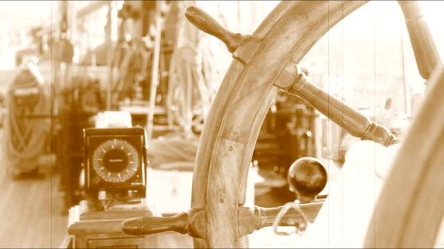 wheel of an old sailing ship and compass video