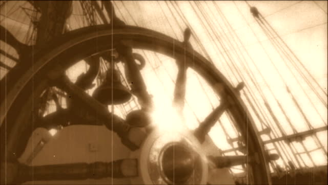 wheel of an old sailing ship - stylized old movie wheel of an old sailing ship - stylized old movie mast sailing stock videos & royalty-free footage