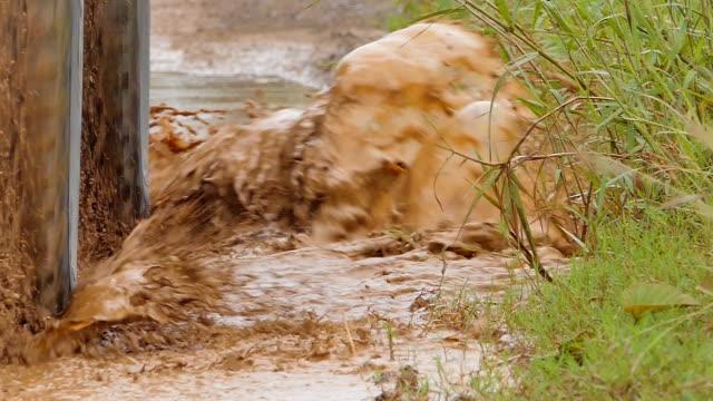 wheel on mud hole. - bike tire tracks video stock e b–roll