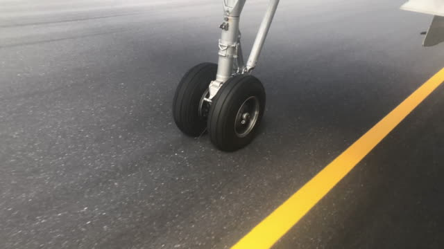 Wheel touching the runway from the plane Wheel touching the runway from the plane airport runway stock videos & royalty-free footage
