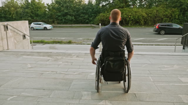 Wheelchair-bound businessman faces inaccessible stairs
