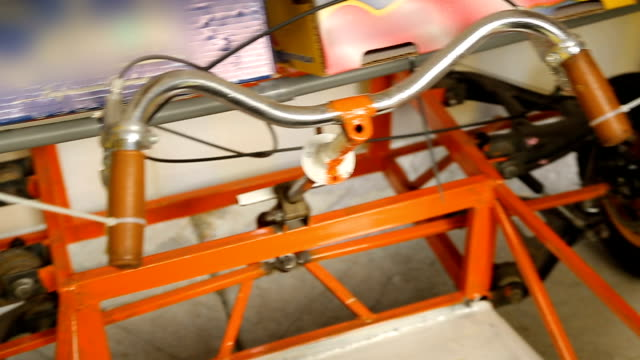 Wheels and handle bar of handmade vehicle for mechanical engineering competition video