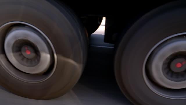Wheels of a Semi-Truck Rolling on Highway