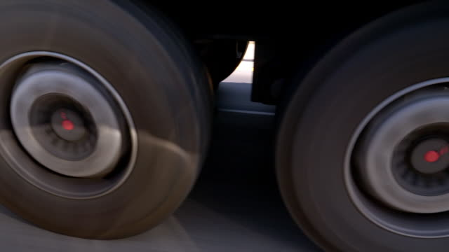 Wheels of a Semi-Truck Rolling on Highway Point of view shot semi truck stock videos & royalty-free footage