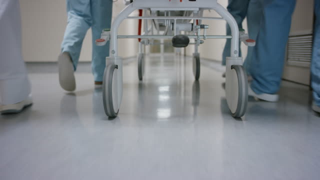 DS Wheels on the gurney being pushed down the hospital hallway video