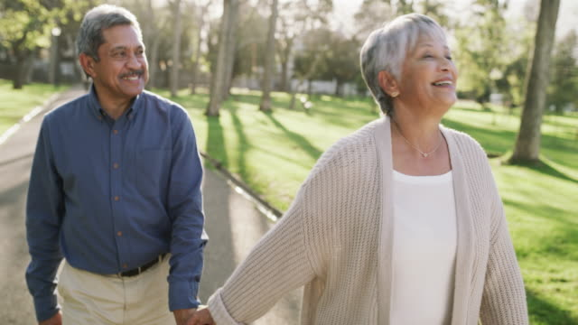 When retirement feels like one big vacation 4k video footage of a happy senior couple going for a relaxing walk in the park husband stock videos & royalty-free footage