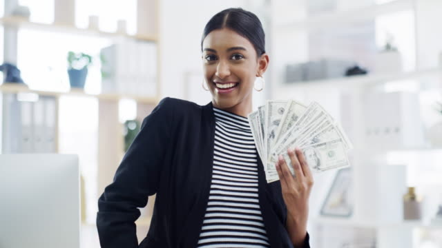 When you've worked for it, why not enjoy it 4k video footage of a young businesswoman holding dollars in a modern office luck stock videos & royalty-free footage