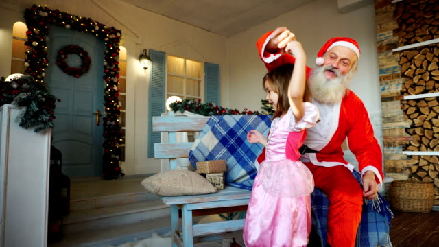 Whirling little girl and cheerful Santa Claus video