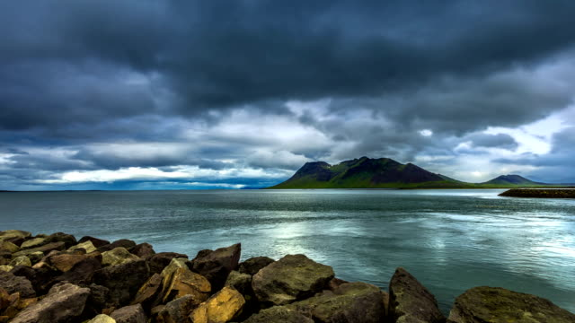 Whirlpool of water and the storm clouds in the strait the Atlantic ocean. Iceland video