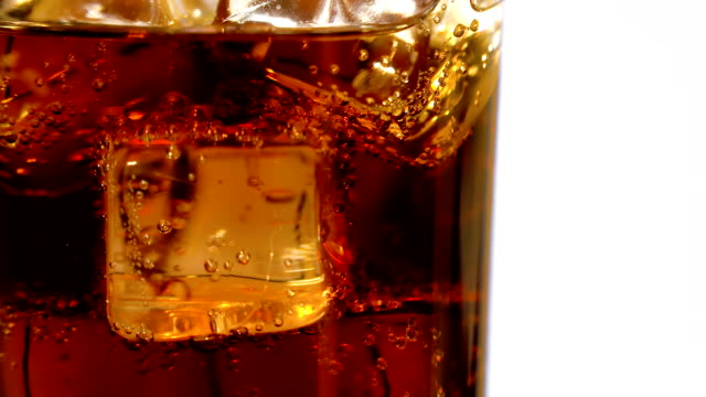 whiskey in a glass with ice cubes - brandy video stock e b–roll