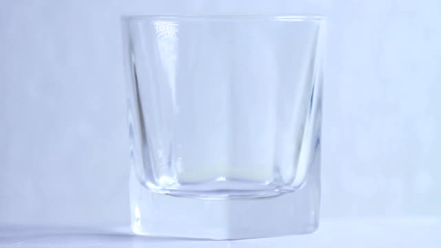 whiskey in a glass with ice video