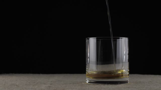 whiskey is poured into a glass video