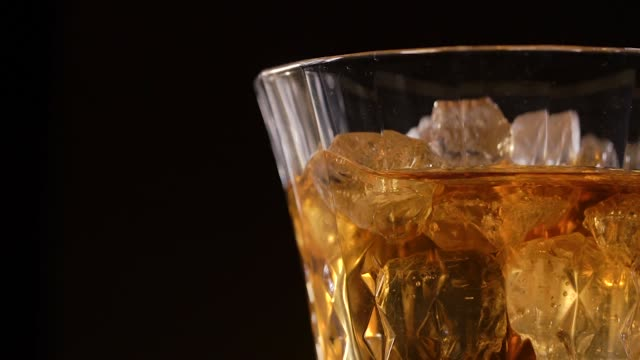 whiskey on the rocks in old fashion glass - scotch whisky video stock e b–roll
