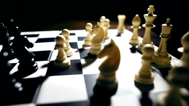 White and black pieces on a chess board