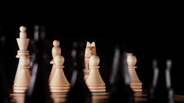 White and black pieces on chess board video