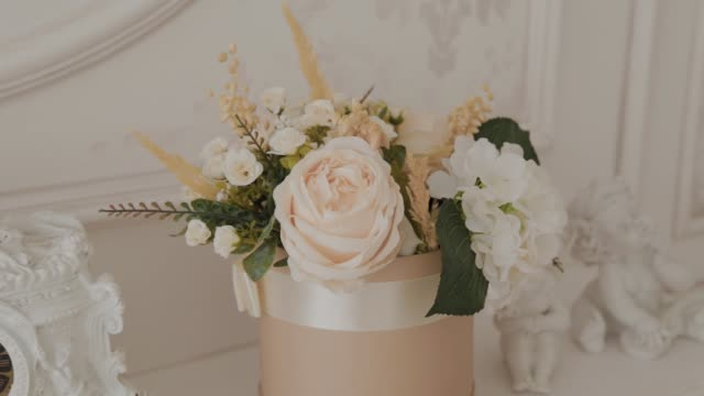 White artificial flowers in a gift basket