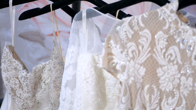 White beautiful wedding dresses in boutique video