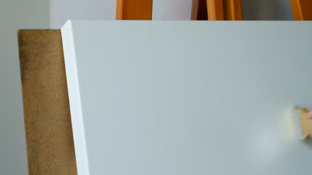 4K : White blank canvas and brush actions,  painting by women hand. 4K : White blank canvas and brush actions,  painting by women hand. durability stock videos & royalty-free footage