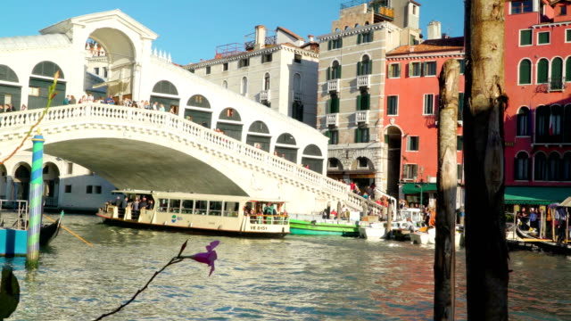 A white boat crossing under the bridge in Venice Italy video
