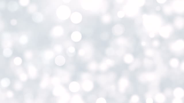 white bokeh lights and particles background - argentato video stock e b–roll
