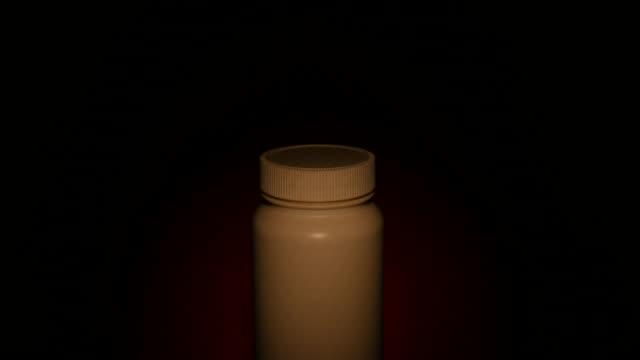 White Bottle of medicine in light video