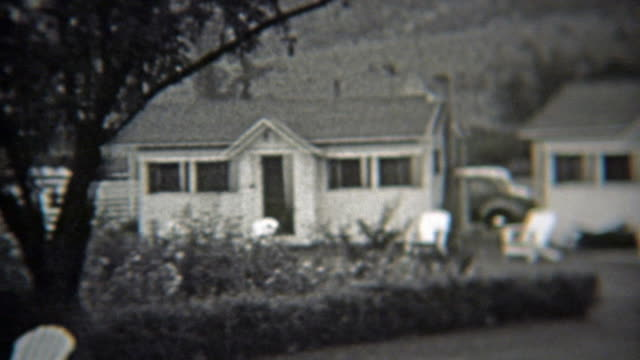 1937: White cabin country living residential community summer getaway. video