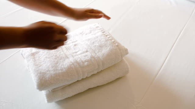 White clean towels on the bed video